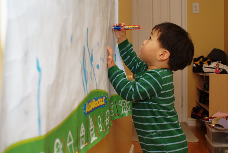 Nathan drawing on wall with the Aquadoodle